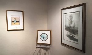 Gallery display of Pat Buckley Moss etching and watercolor